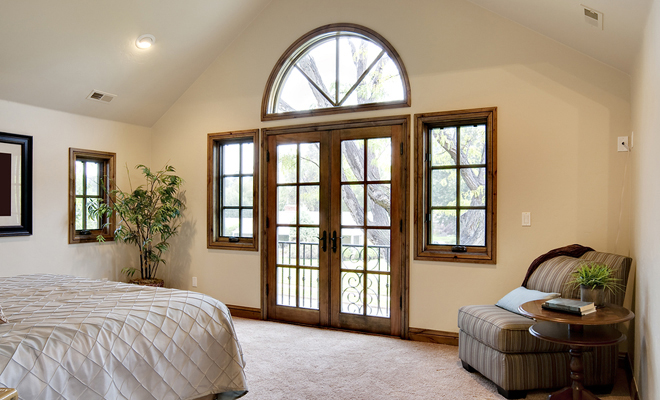 Bedroom with French Door and Balcony